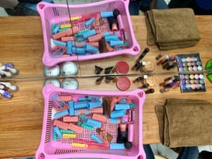 Lipsticks, nail varnish and hair-rollersat the Beauty Corner