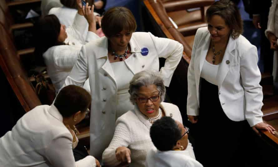 Democratic members of the House of Representatives talk before Trump's address. Many women wore white in protest – a nod to the suffragette movement.