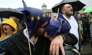 A couple kiss as they hold European flags at an anti-Brexit protest in Trafalgar Square.
