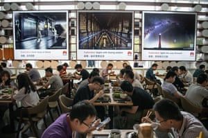 Huawei workers eat subsidised lunch in one of many cafeterias at the company's Bantian campus
