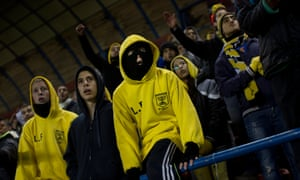 Beitar Jerusalem fans watch a home game at Teddy stadium in Israel