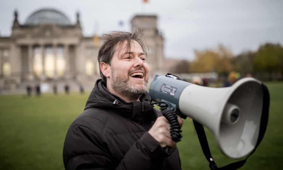Theatre director Milo Rau leads a storming of the Reichstag in Berlin, 7 November 2017.