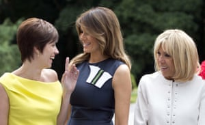 Amelie Derbaudrenghien, the partner of Belgian Prime Minister Charles Michel, left, speaks with US first lady Melania Trump, centre, and French first lady Brigitte Macron