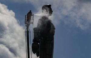 Moscow, Russia. Municipal workers clean the Yuri Gagarin monument in preparation for Cosmonaut Day, the 60th anniversary of his space flight