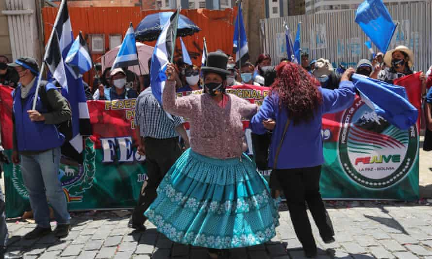Mas supporters celebrate in La Paz, Bolivia, on 19 October.