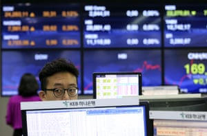 A currency trader works at the foreign exchange dealing room of the KEB Hana Bank headquarters in Seoul, South Korea today.