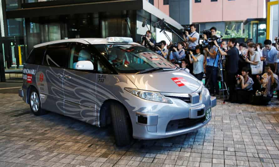 The RoboCar MiniVan at the start of its test in Tokyo