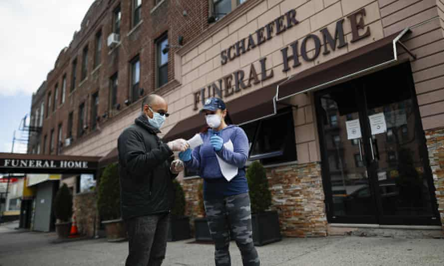 People outside a funeral home in Brooklyn, New York, on 2 April.