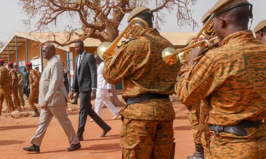 The brass band plays as the Burkinabè president leaves Flintlock.