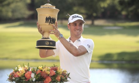 Justin Thomas hoists the Gary Player Cup after the final round of the World Golf Championships-FedEx St. Jude Invitational golf tournament at TPC Southwind in Memphis