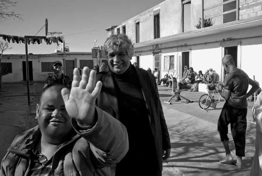 Pastor José Antonio Galvan with Yogi and other residents of the Visión En Acción centre in Ciudad Juárez.