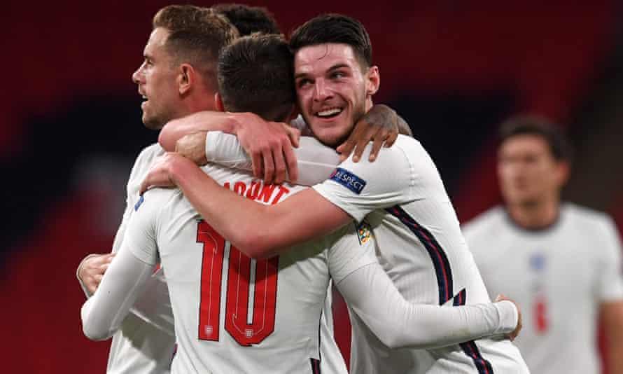 Declan Rice congratulates Mason Mount on his fellow midfielder's winning goal for England against Belgium at Wembley.