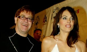 Elton John and Elizabeth Hurley.