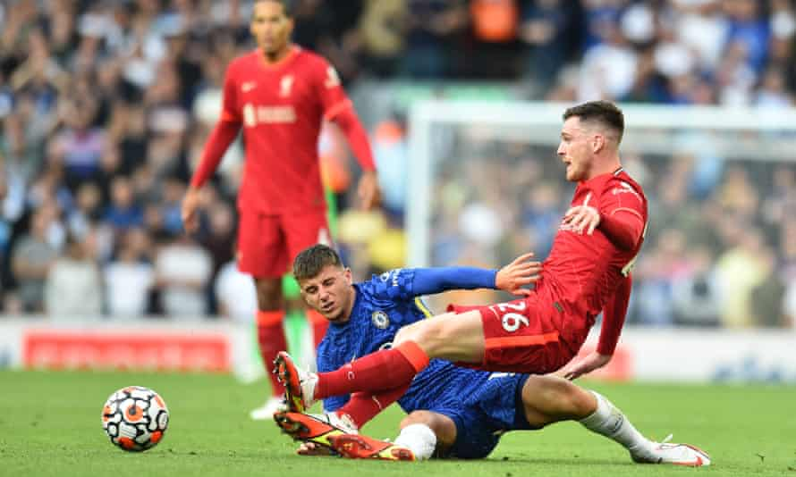 Chelsea's Mason Mount and Liverpool's Andy Robertson tangle during the dramatic 1-1 draw at Anfield