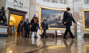 House impeachment managers proceed through the US Capitol building to the Senate chamber on Tuesday in Washington DC.