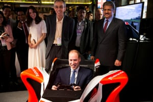 Prince William rides in a driving simulator while meeting young entrepreneurs in Mumbai