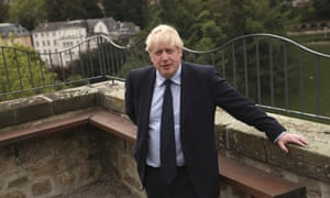 Boris Johnson on the balcony of the UK ambassador's residence in Luxembourg where he gave TV interviews after the press conference that he missed because of the noisy protesters.