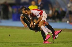 Arsenal's Alexis Sanchez is fouled by Zagreb's El Arabi Hilal Soudani.