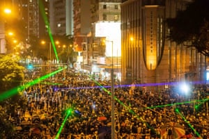 Protestors shine laser pointers during a clash at Admiralty district on August 31, 2019