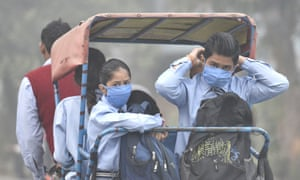 People wearing air pollution masks in Delhi