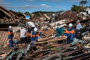 Search and rescue crews salvage belongings from the debris of buildings destroyed by a tornado shortly before the arrival of Typhoon Hagibis, on October 13, 2019 in Chiba, Japan.