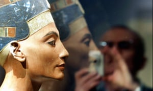 A visitor takes pictures of the bust of Egyptian queen Nefertiti in Berlin.