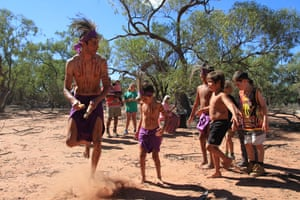 Bruce Shillingsworth leads young family members in a traditional dance for a Budjiti ceremony to return displaced artefacts.