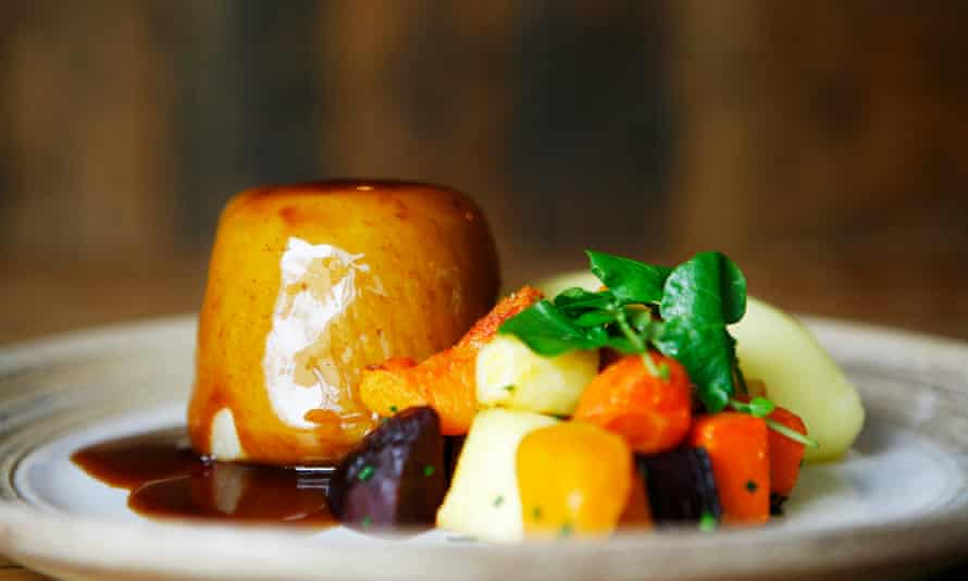 Proper grub: oxtail, beef skirt and real ale suet pudding with olive oil mash and seasonal vegetables at the Cartford Inn, Little Eccleston, Lancashire.