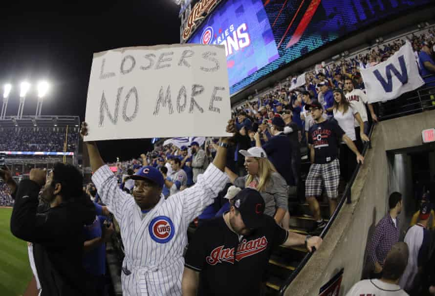 A fan react after the Cubs won Game 7.