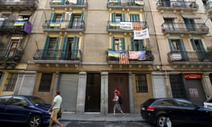 Banners against tourist apartments hang from balconies in Barcelona