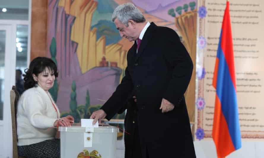 President Serzh Sargsyan casts his vote during Sunday's referendum.
