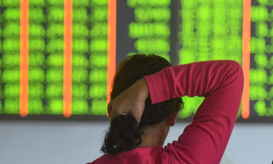 An investor monitors stock prices at a Chinese securities firm in Hangzhou.