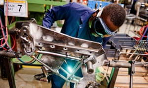 A worker brazes components of a folding bike in a factory in south-west London.
