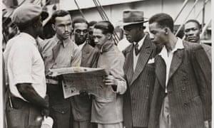 Men waiting to disembark from the Empire Windrush on 21 June 1948.