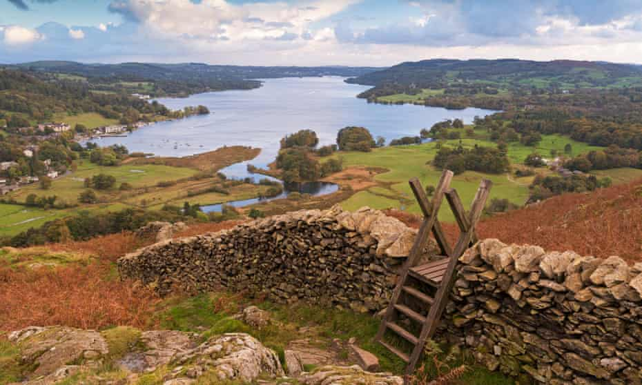 Drystone wall and stile with view of Windermere in the Lake District