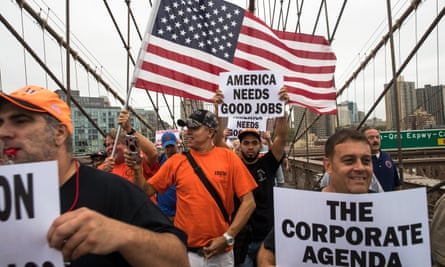 Union members march across Brooklyn Bridge in support of union members striking for a better contract. New York governor Andrew Cuomo and AFL-CIO president Richard Trumka joined the march.