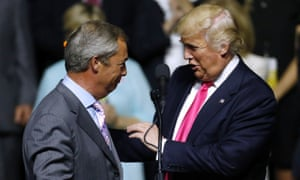 Donald Trump, right, greets Nigel Farage during a campaign rally