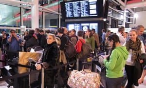 Passengers line up in Heathrow Terminal Three