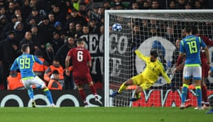 Alisson Becker saves from Napoli's Milik.
