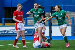 Ireland's Hannah Tyrrell (centre) celebrates scoring a try.