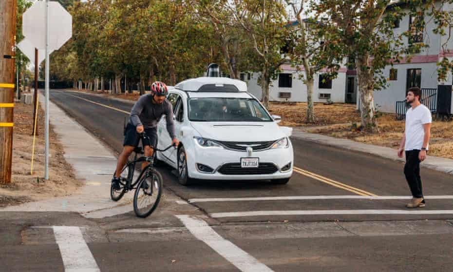 car and cyclist