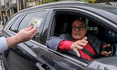 Rudy Giuliani drives by a protest in New York
