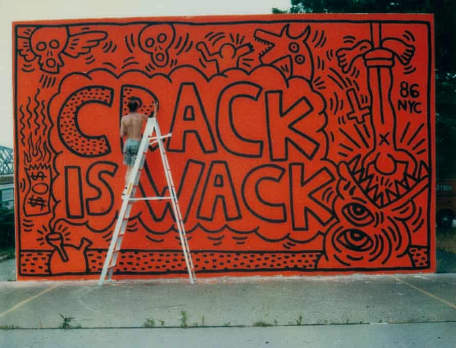 Keith Haring painting the Crack is Whack mural in Harlem.