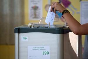A voter casts her ballot