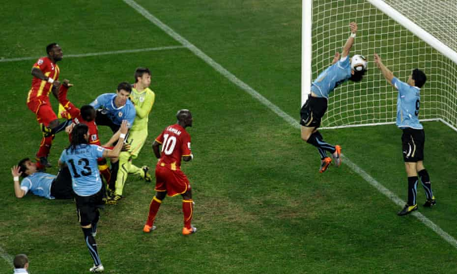 Luis Suárez (No 9) handles the ball to deny Ghana a winning goal at the end of extra time.