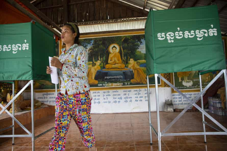 Cambodians cast their vote during an election that has been widely criticised