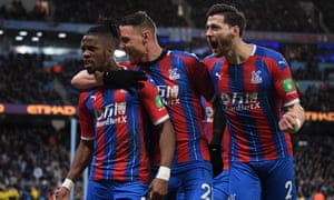 Wilfried Zaha (left), Connor Wickham (centre) and Joel Ward of Crystal Palace celebrate after Fernandinho of Manchester City scored an own-goal which put the Eagles back on level terms.