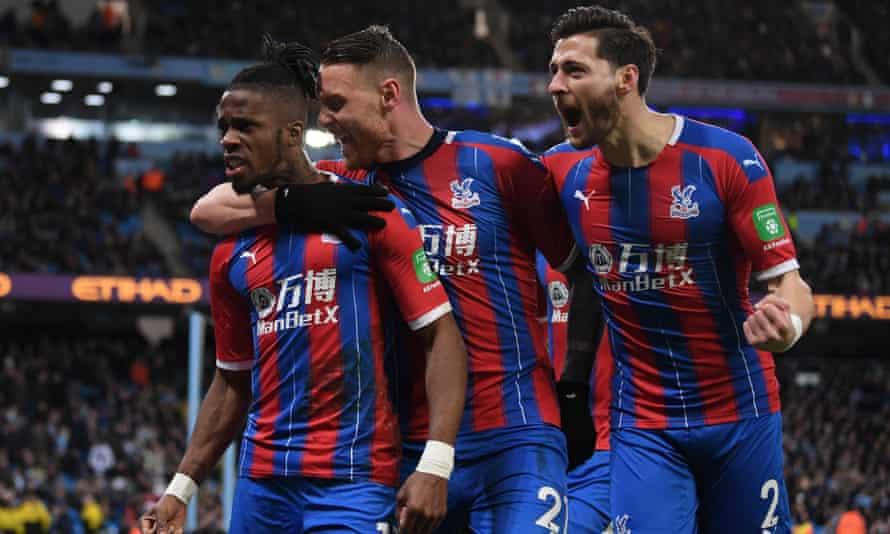 Crystal Palace's Wilfried Zaha, Connor Wickham and Joel Ward celebrate after Fernandinho's own-goal.