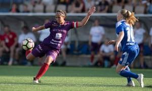 Åland United's Briana Campos takes on Jutta Rantala of HJK Helsinki in May 2019.