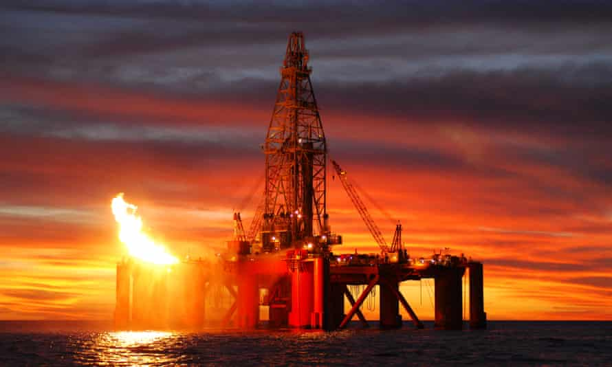 An oil rig situated in the ocean exploring for oil and gas.